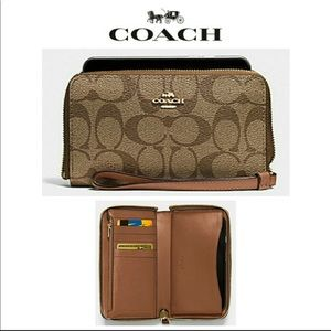 Coach phone wallet in signature canvas